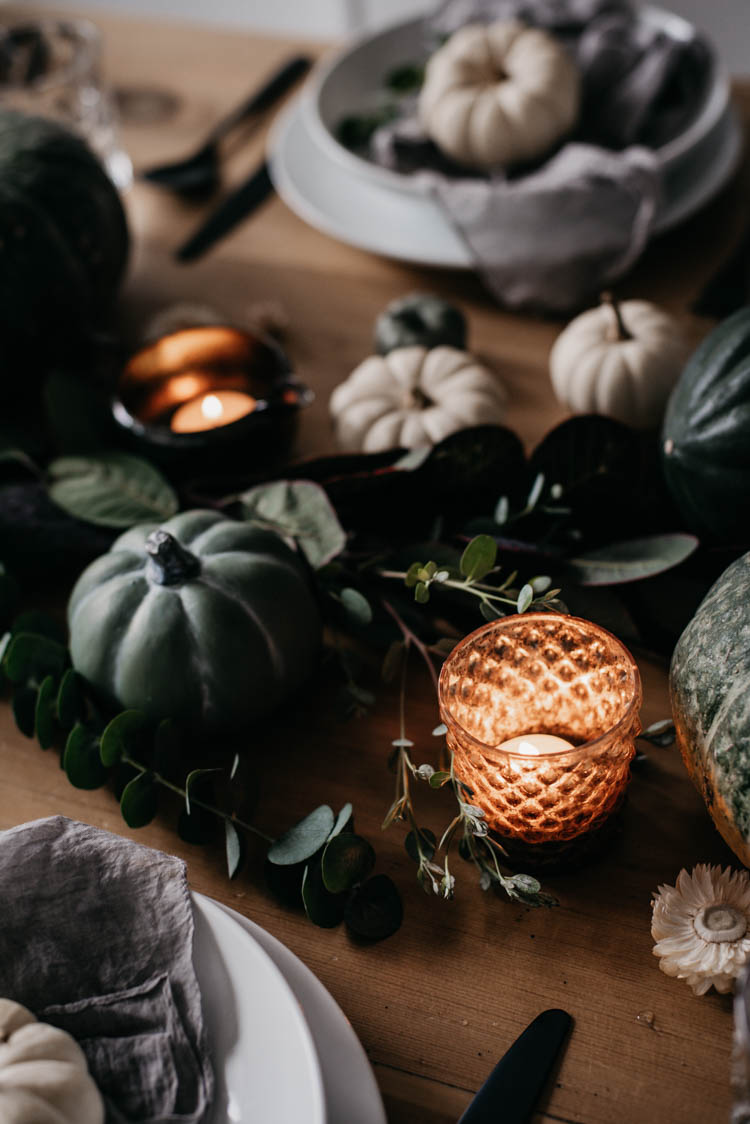 Beautiful fall tablescape with pumpkins, candles, squash and fall foliage. Love how it's low so you can still have conversation with everyone at the table... and the neutral colours are perfect!
