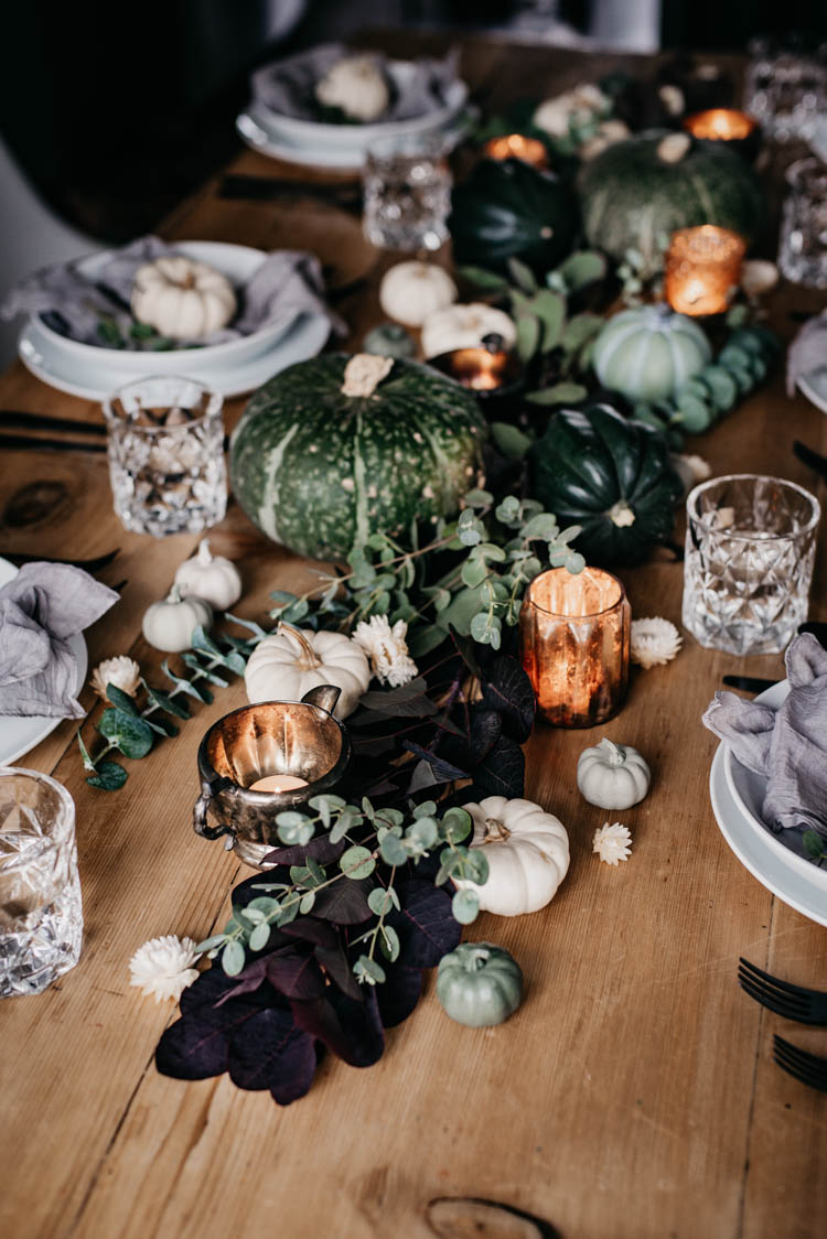 Beautiful green autumn tablescape with hand lettered pumpkin place cards for thanksgiving