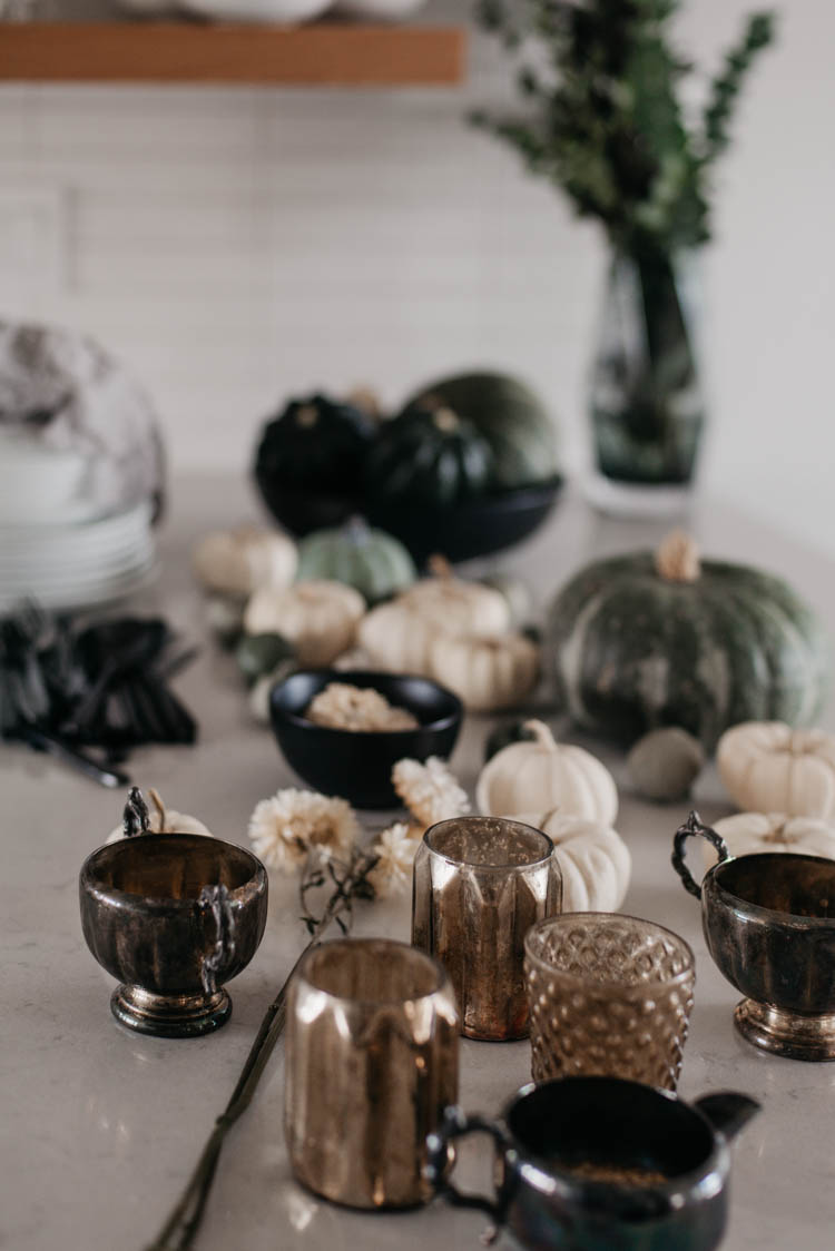 Candleholders and pumpkins for an autumn tablescape