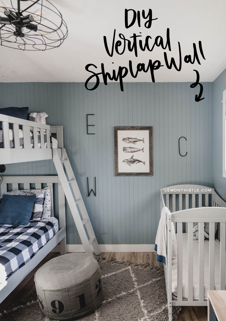 Finished space with the skinny vertical shiplap wall- text overlay DIY vertical shiplap wall