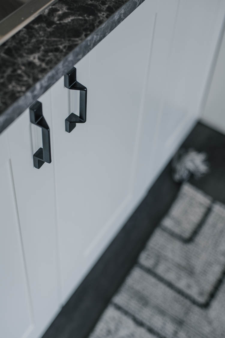 Modern black hardware- love the geometric shape of these on the white shaker cabinets!