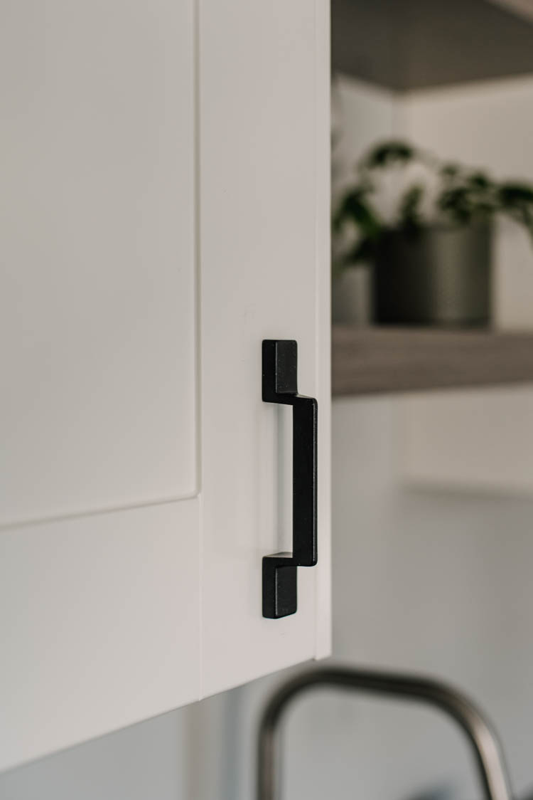 geometric black cabinet pulls on white shaker fronts
