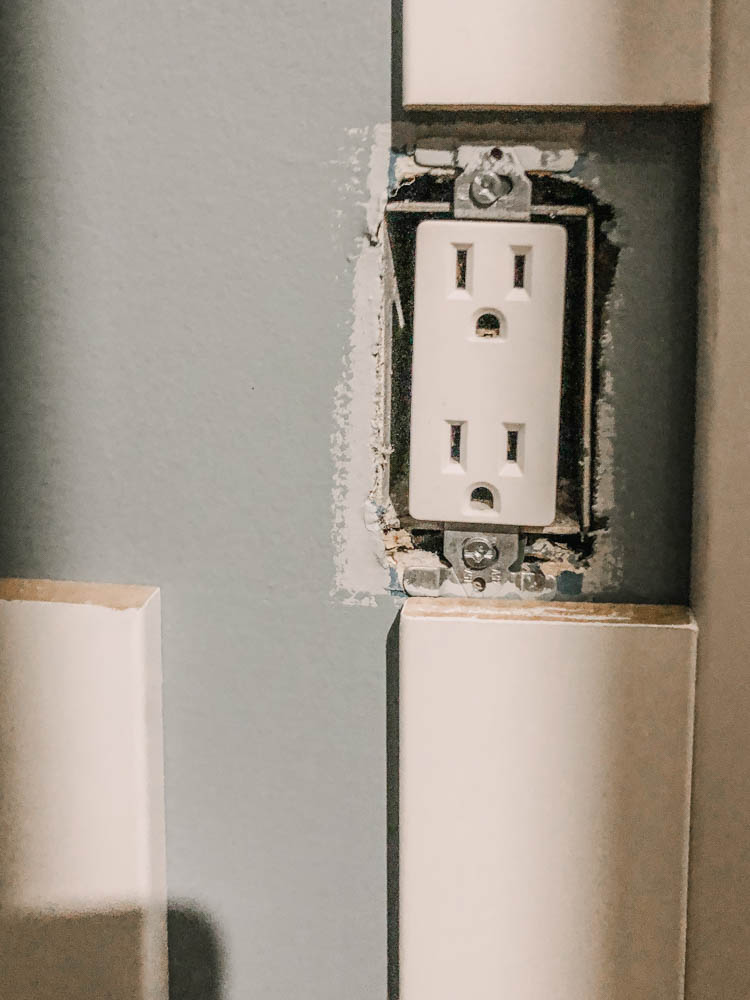The EASIEST way to put together a DIY skinny vertical shiplap wall (and how to deal with plugs)