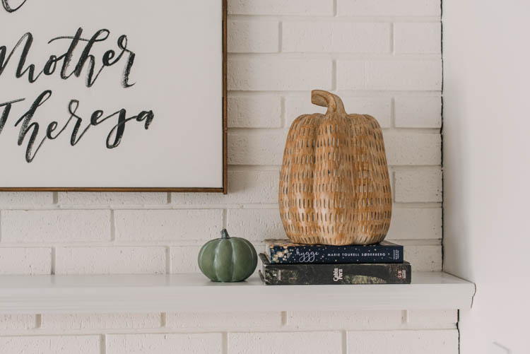 Wooden look pumpkin for autumn mantel decor- stacked on books to add height