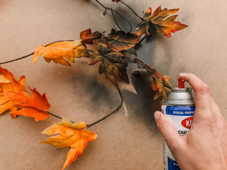 Transforming dollar store garlands into halloween decorations with spray paint