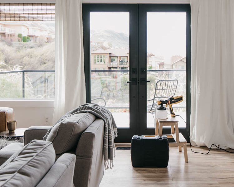 How we painted our patio doors black (including masking off the living room!) and the before and after- it makes SUCH a big difference in the feel of the space