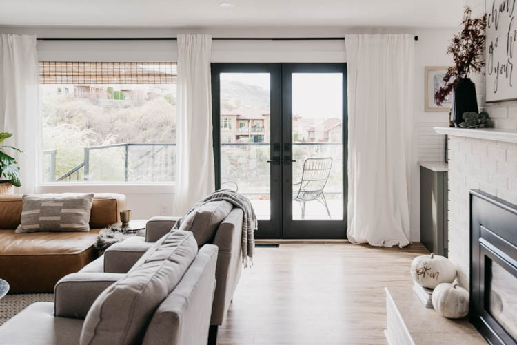 Black french doors in a white living room