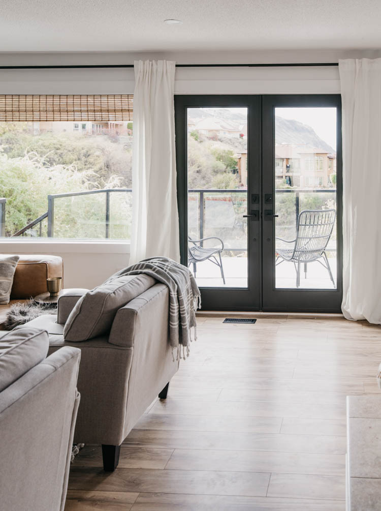 Black painted french doors in a modern living room (flush glaze glass doors)