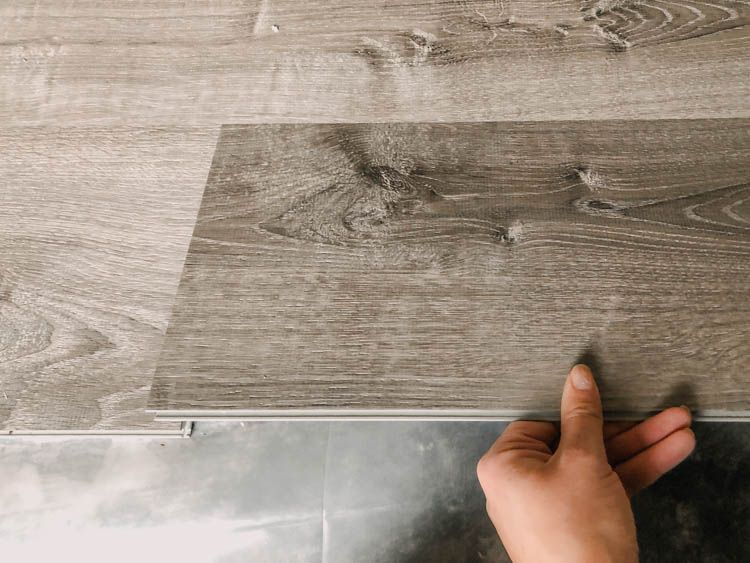 Tips on installing vinyl plank flooring over concrete (and what to look for in a flooring!)