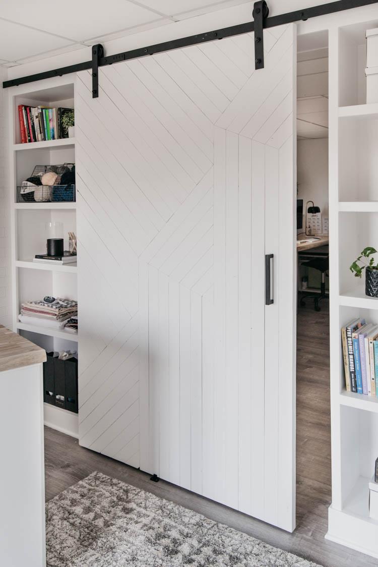 DIY Modern barn door over built in shelving