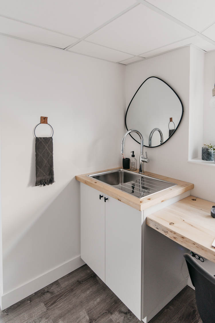Sink corner in a basement office- perfect for water refills and paintbrush washing