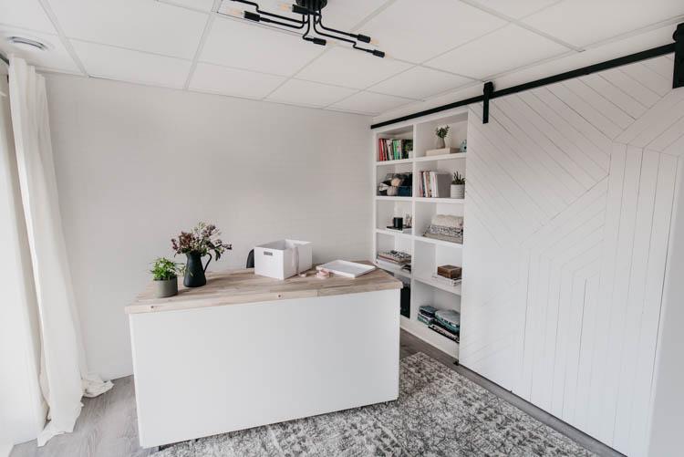 DIY built in shelving with barn door overtop for a studio