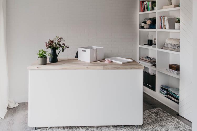 beautiful bright white craft studio in a basement
