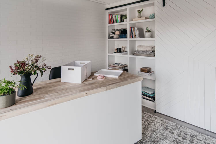 DIY built in shelving with rolling door... and rolling craft table in this office makeover