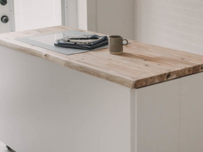 DIY craft table with hidden storage- love the counter height!