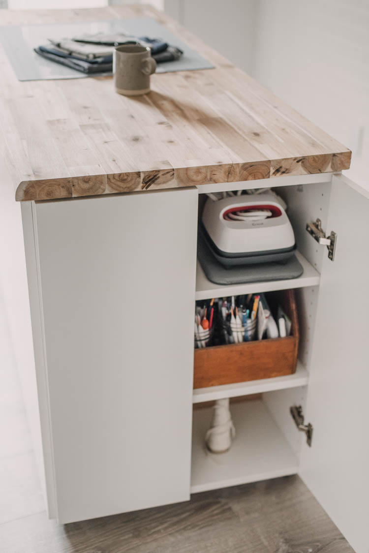 DIY Rolling craft table made from affordable kitchen cabinets!
