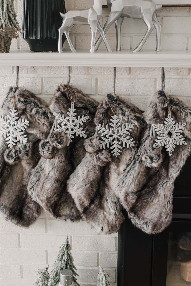 Faux fur stockings with metal snowflake ornaments