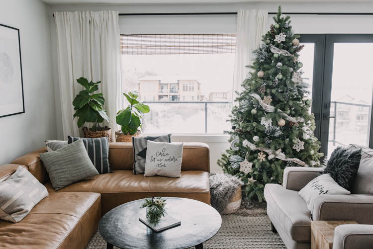 Cozy neutrals holiday decorations- with that leather sectional!