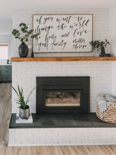 modern rustic diy brick fireplace makeover... love the painted brick, tile hearth and the chunky wood mantel