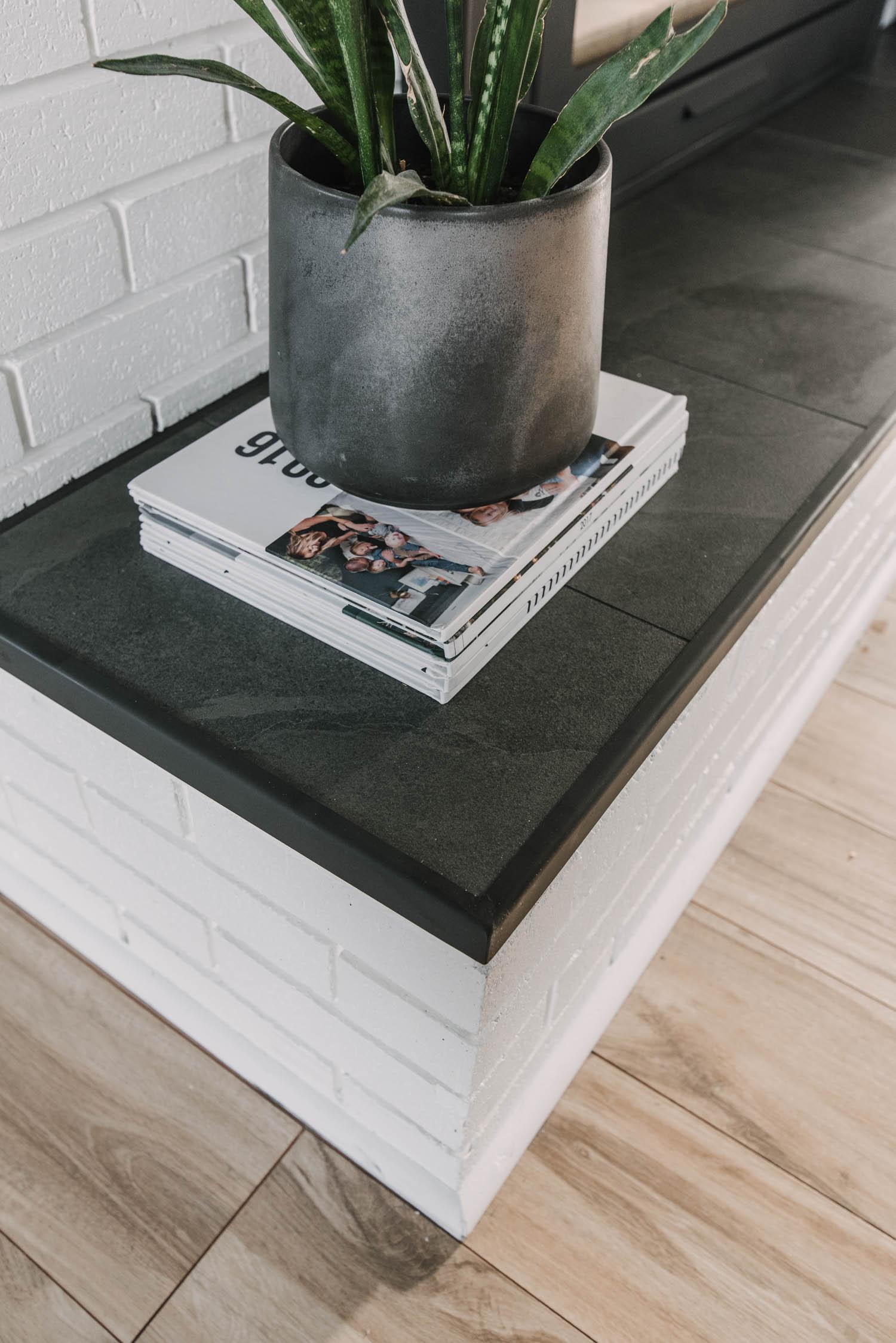 custom metal edge for tiled hearth