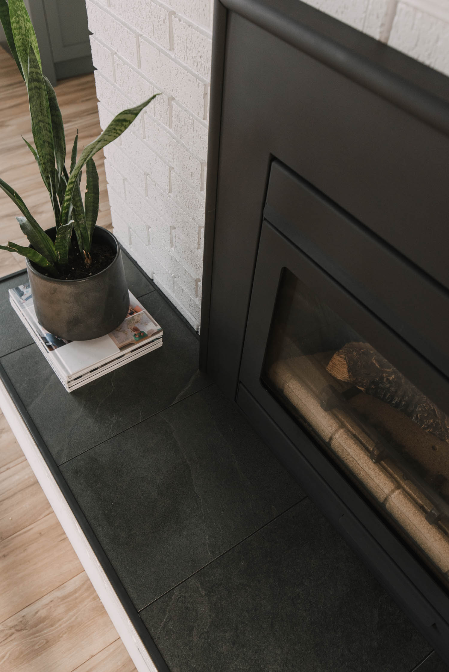 Black tile hearth to mimic slate