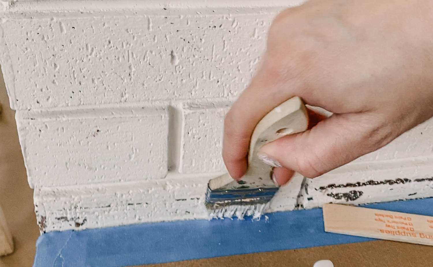 How to paint brick fireplace by hand or with a paint sprayer