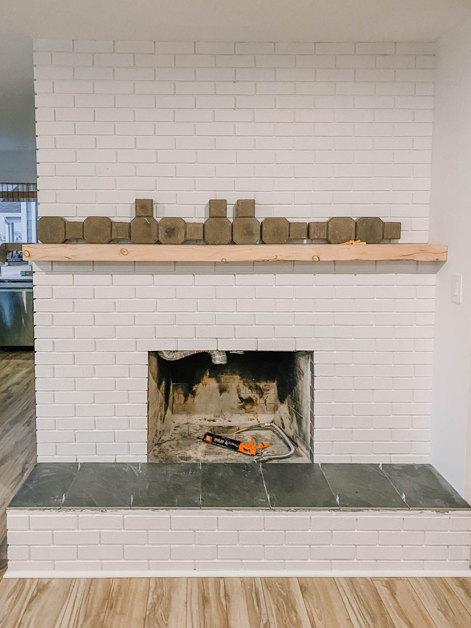 How to install a chunky wood mantel on brick