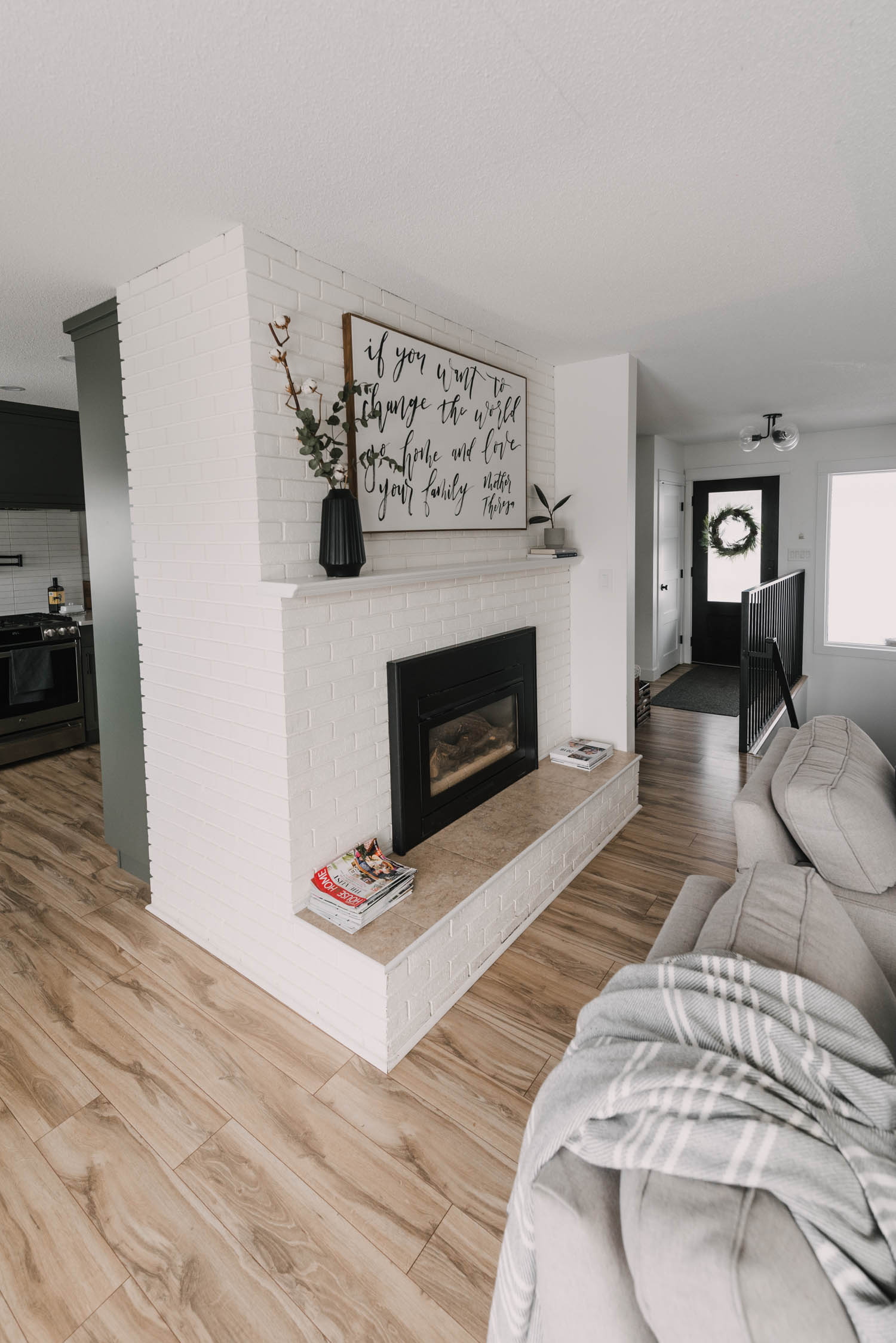 Large fireplace in the centre of all spaces for this Semi Open Concept floor plan for a rancher