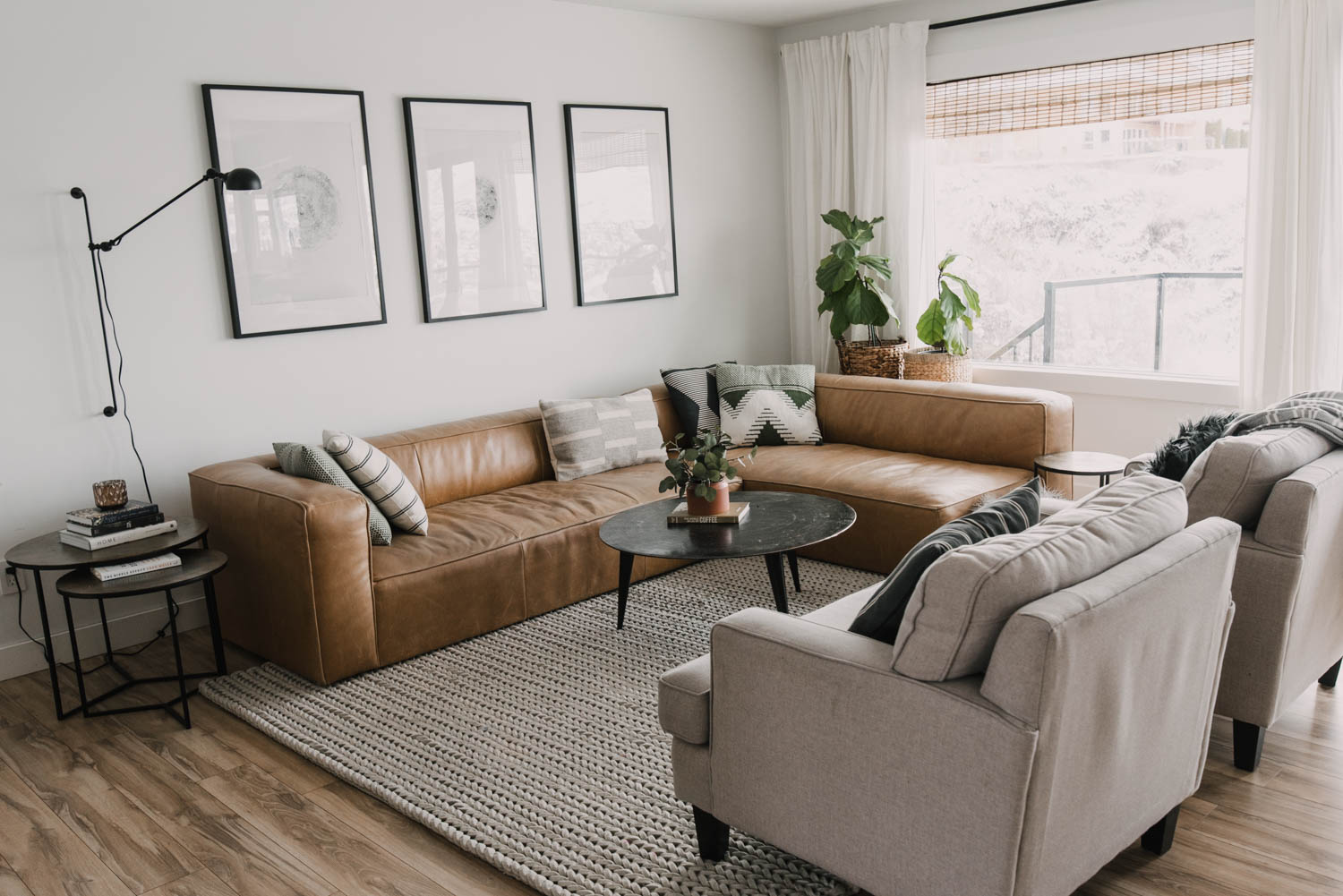 Modern ranch style living room with camel leather couch