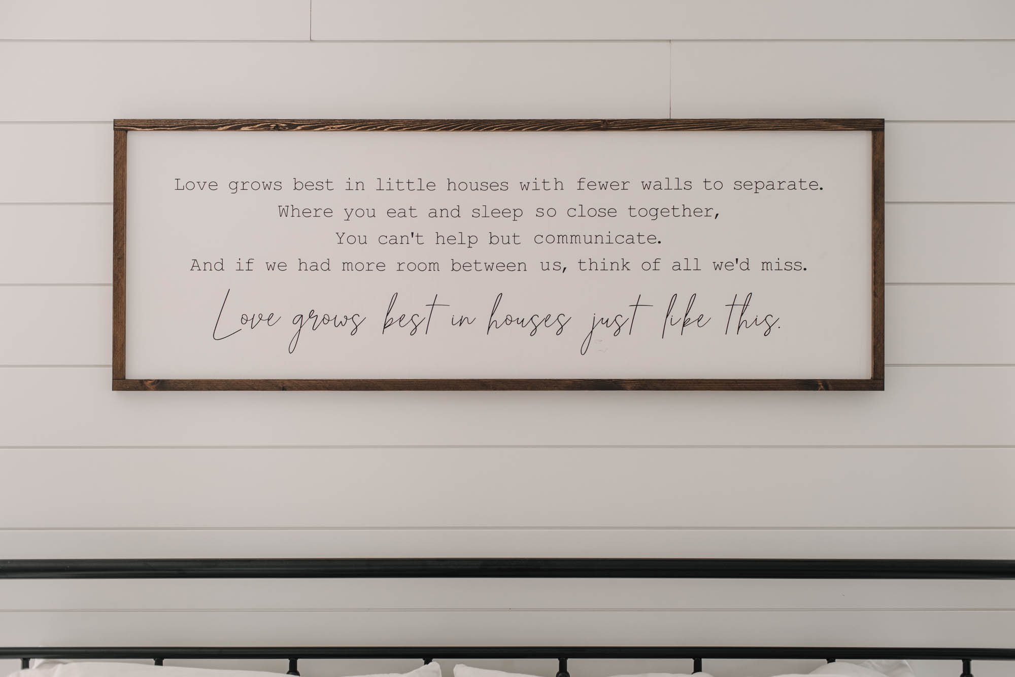 Farmhouse bedroom decor with wooden sign: love grows best in little houses
