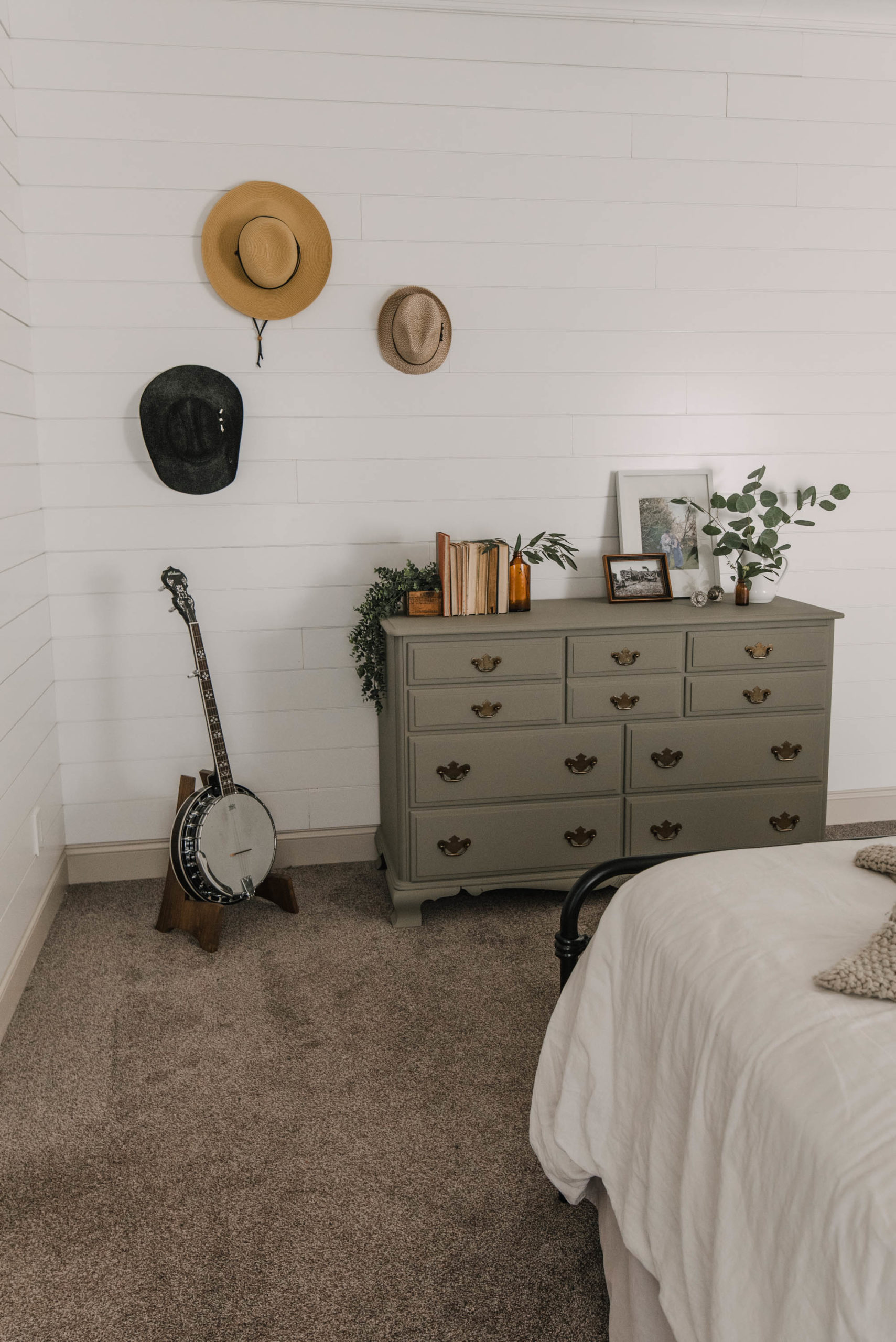 Green Painted dresser with hat wall in a shiplap bedroom (actually a mobile home!)