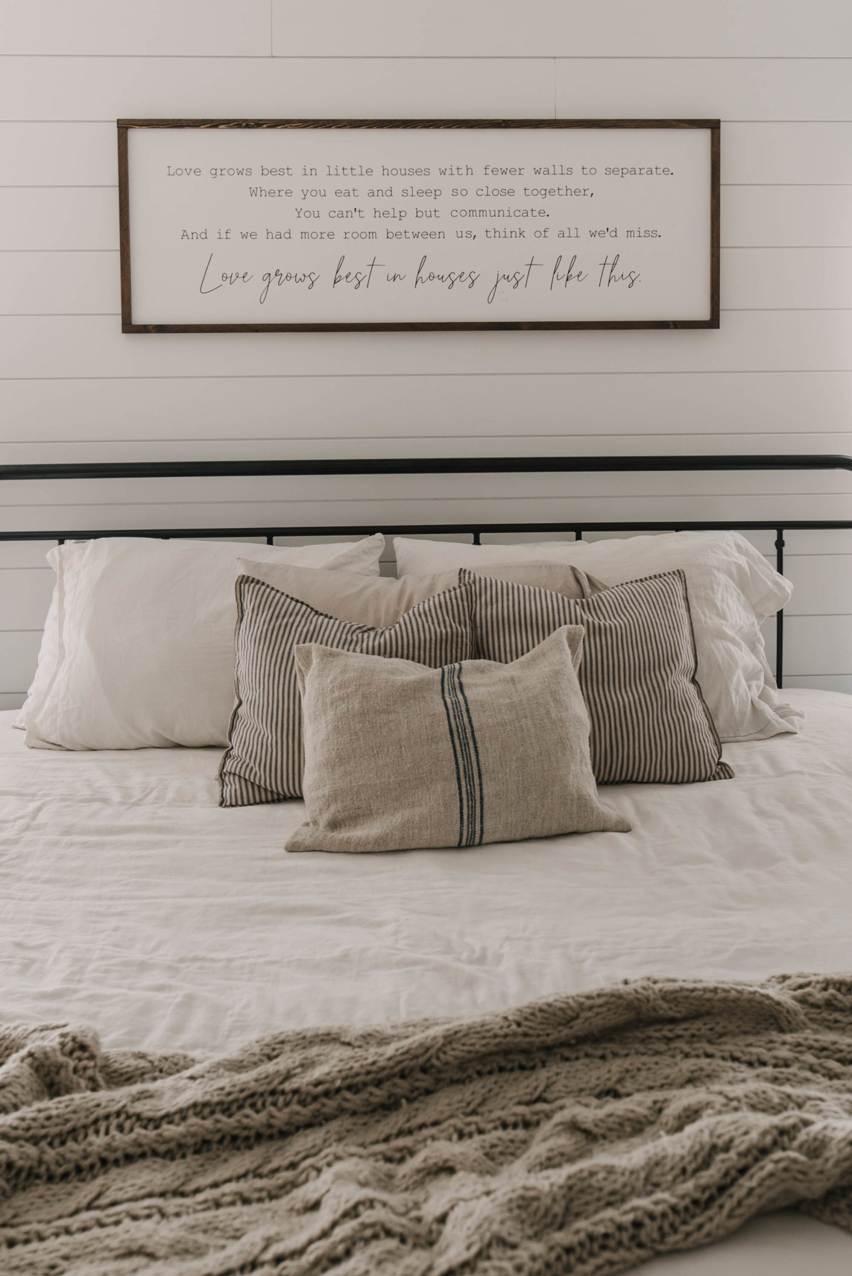 Farmhouse bedroom decor with wooden sign
