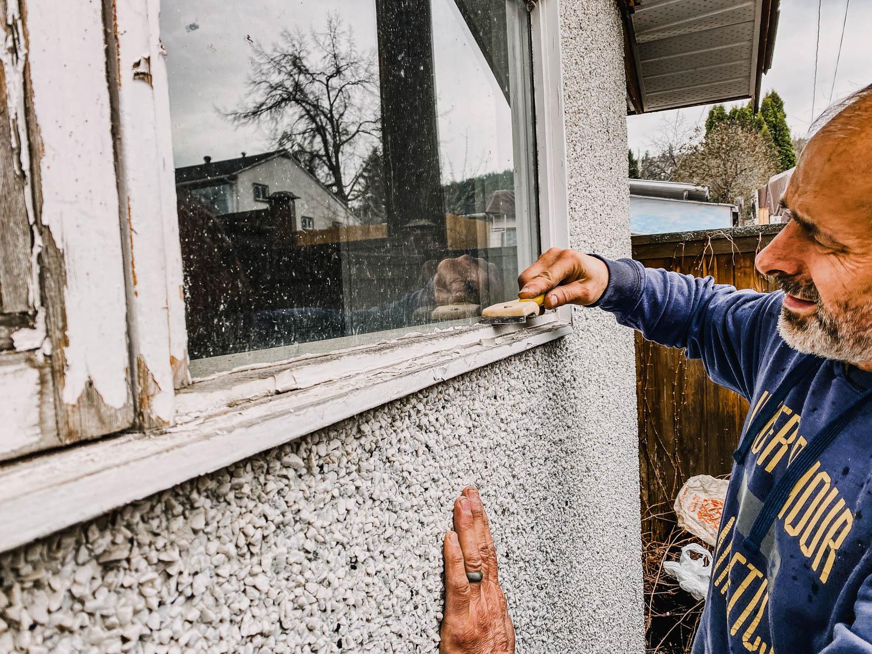 scrape flaking paint off window trim