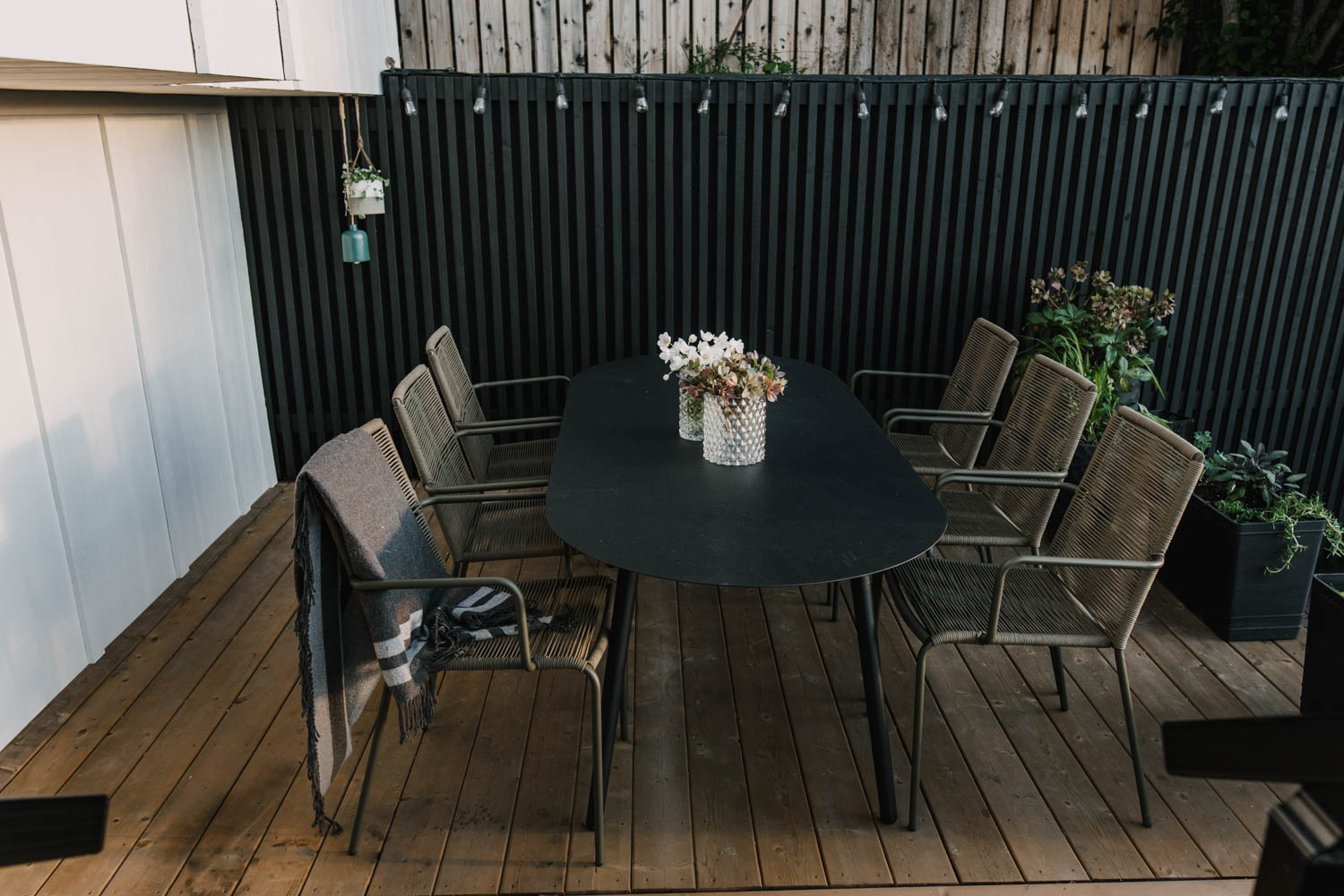 Black white and wood patio from above