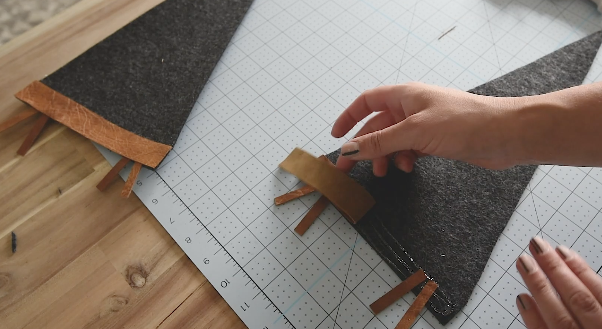 hot glue leather to the felt pennant
