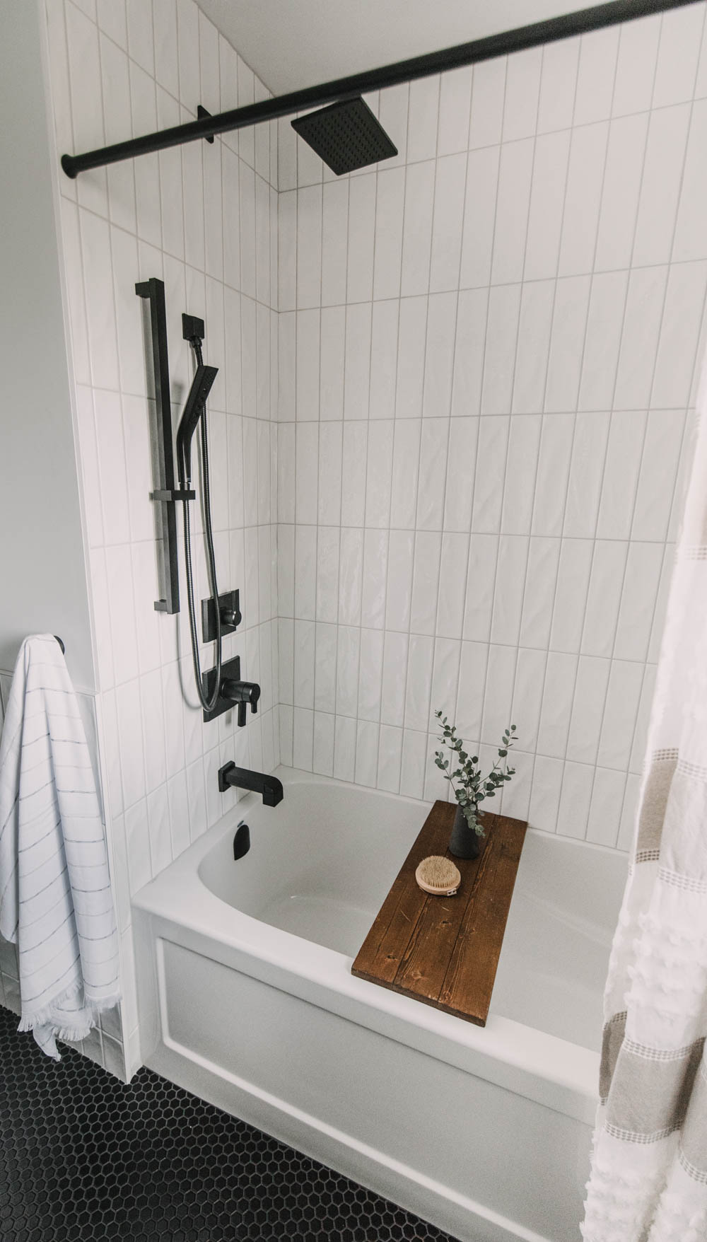 Modern black fixtures for a tub shower combo