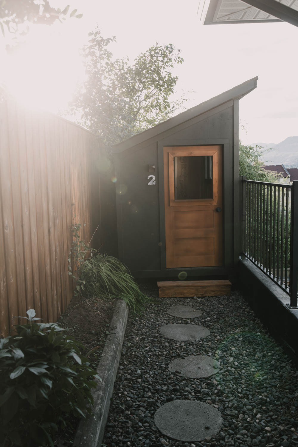 Modern single pitch playhouse with wooden door