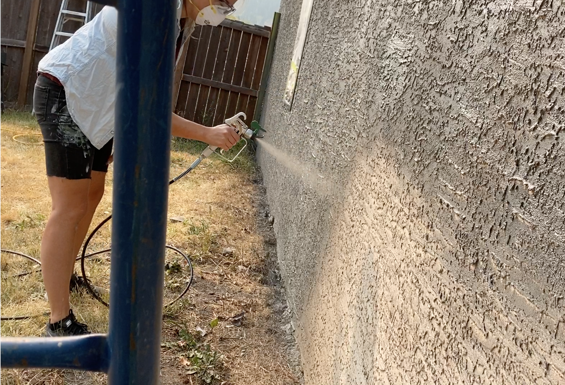 Painting an exterior with a sprayer