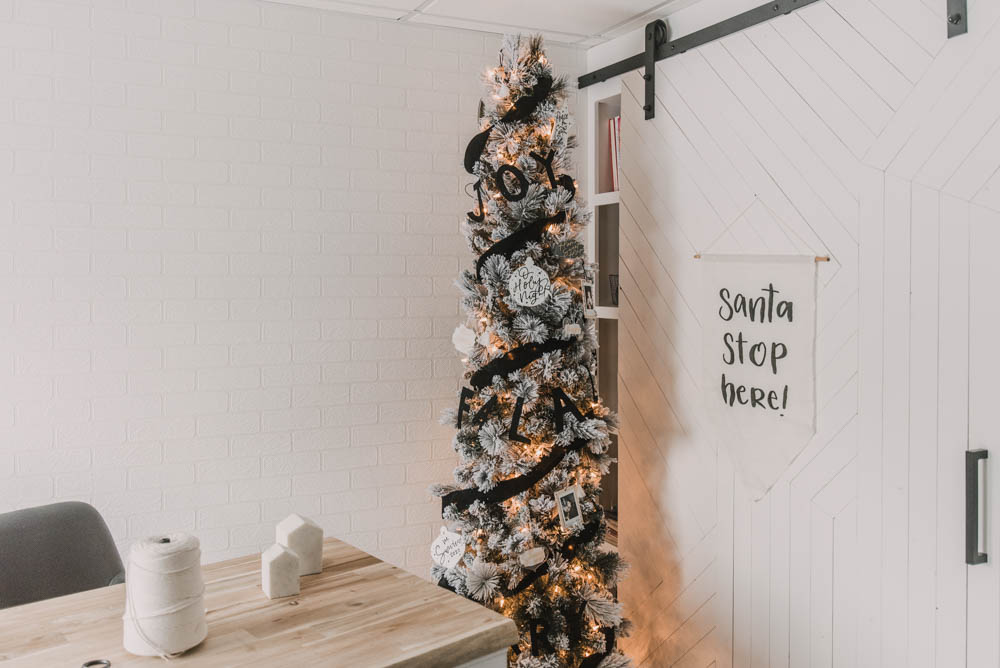 Modern black and white flocked christmas tree decor