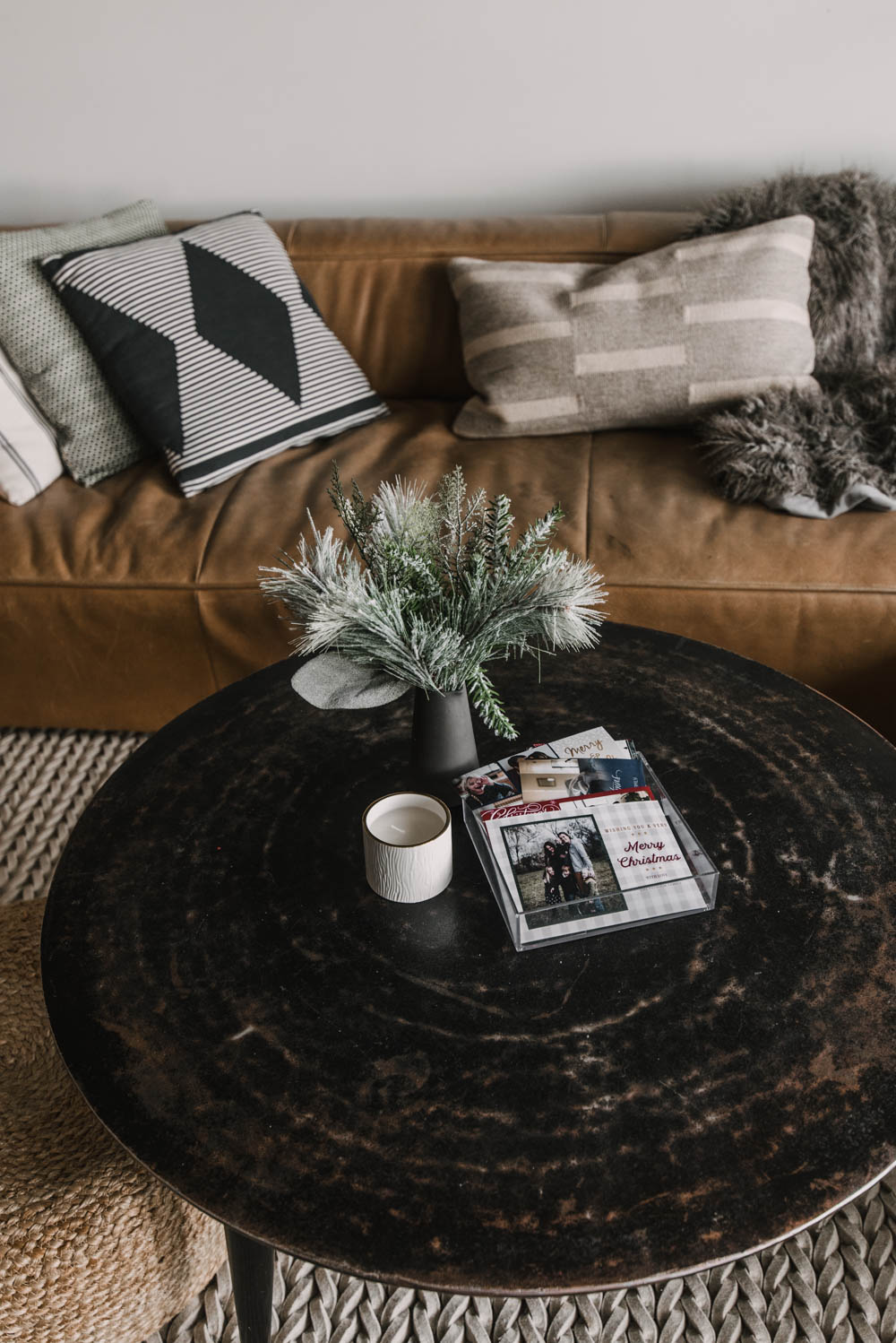 photo holiday cards in basket on coffee table
