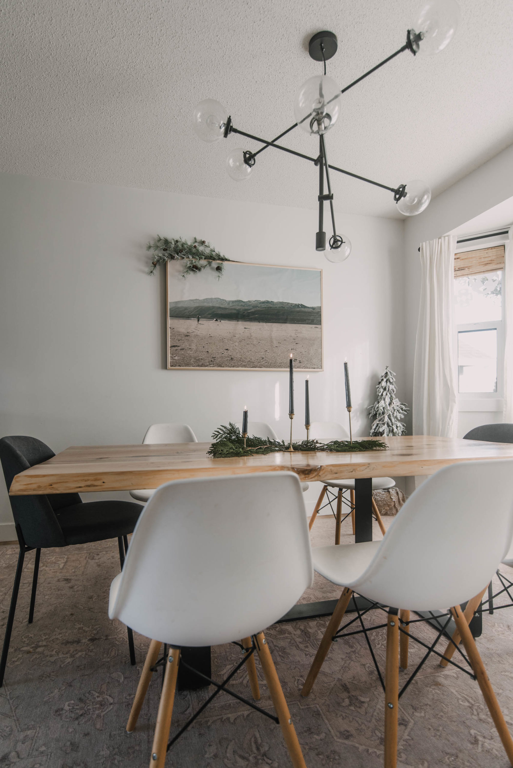 Neutral dining room decorated for the holidays
