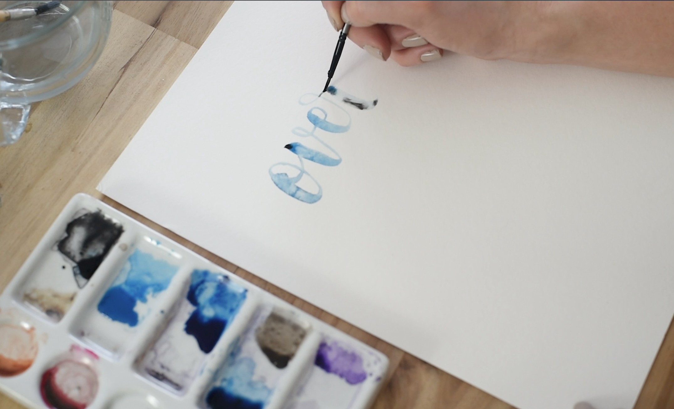 blending black and blue in hand lettering using water