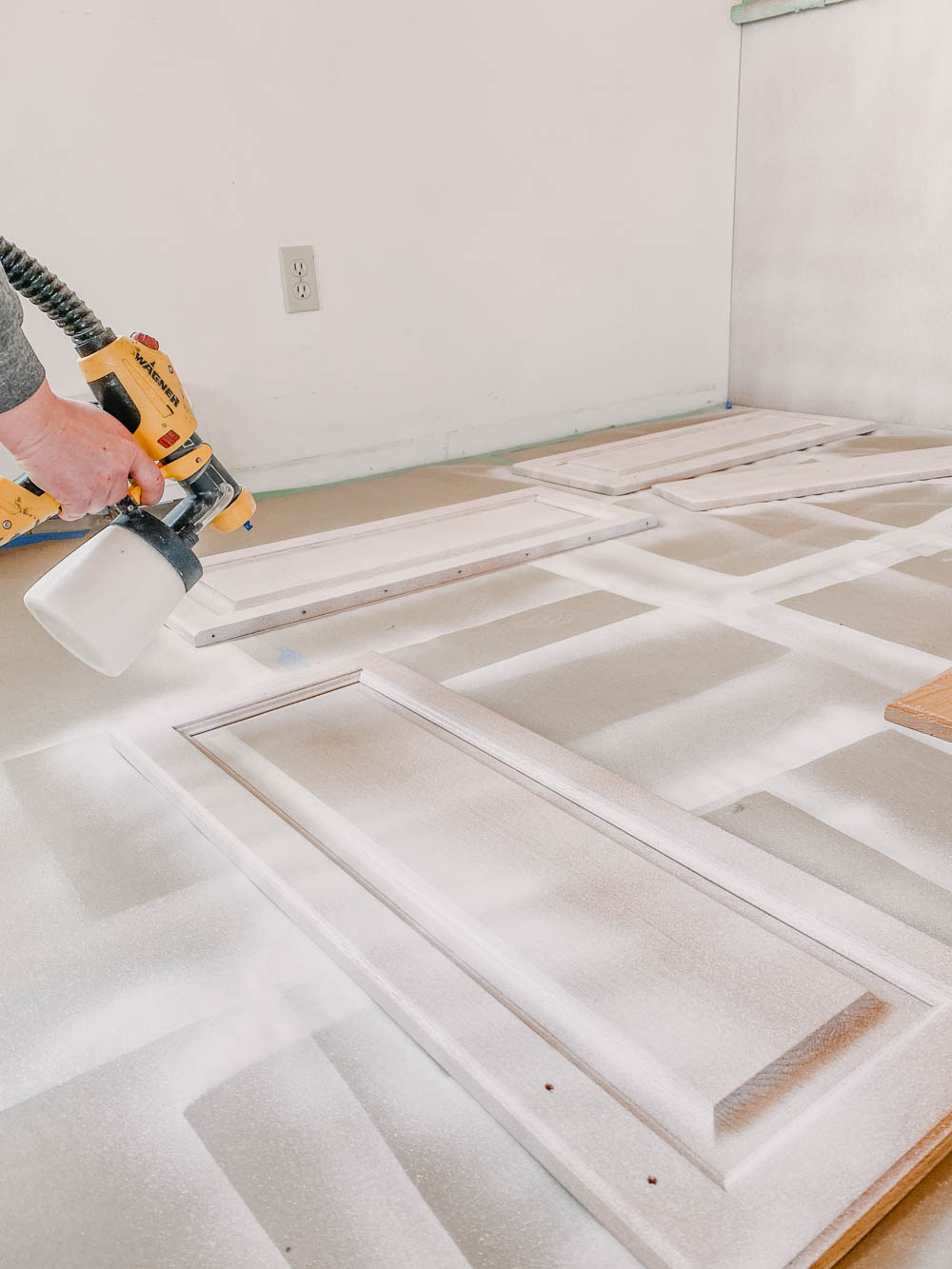 Spraying Paint for Cabinets