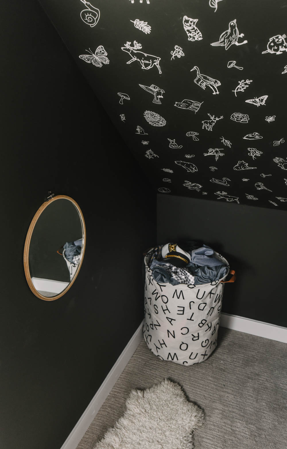 Under stairs closet turned into dress up space for kids playroom