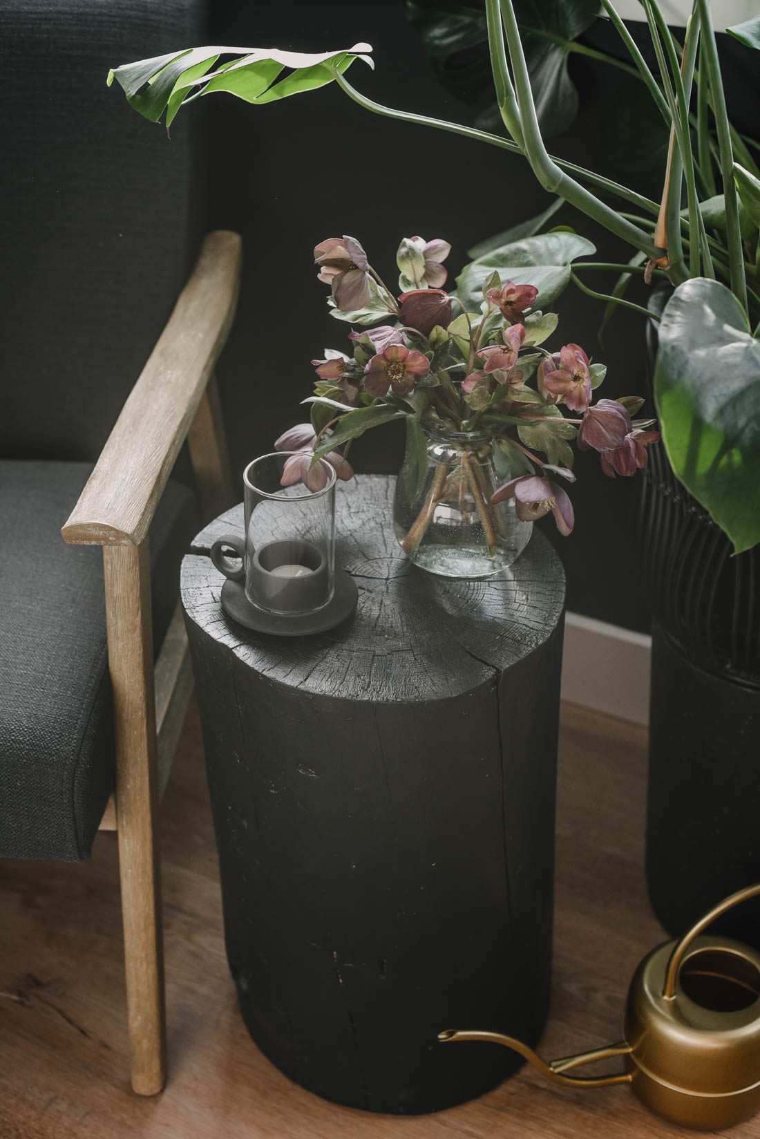 Painted black tree stumps as end tables