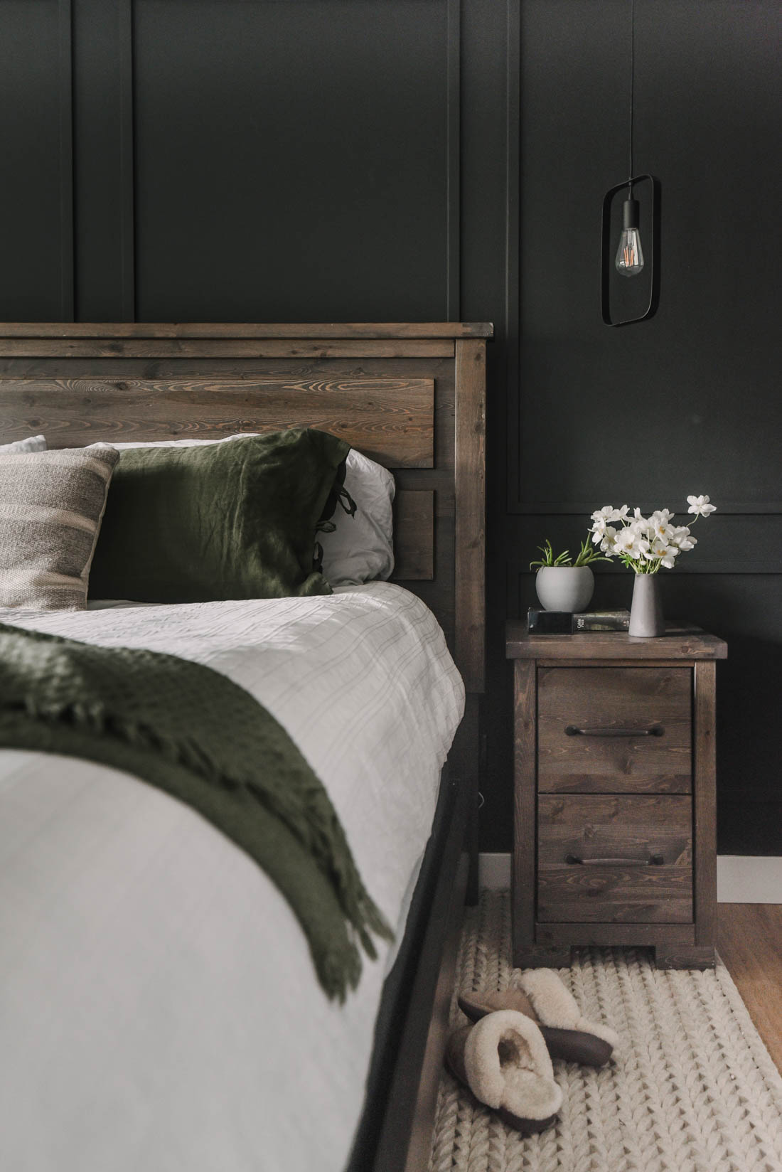 Black bedroom with wood furniture