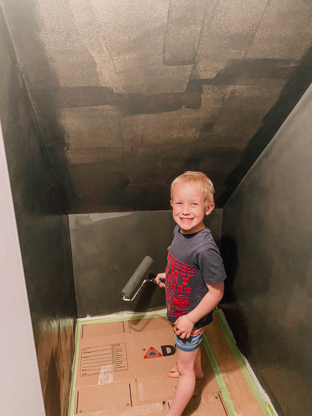 Kids Helping Paint under stairs to dress up nook
