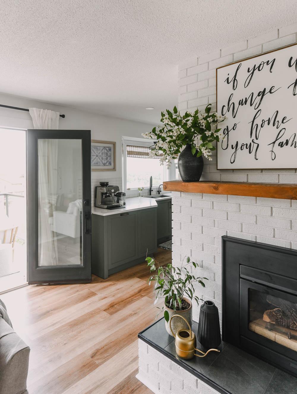 patio doors open to brick fireplace