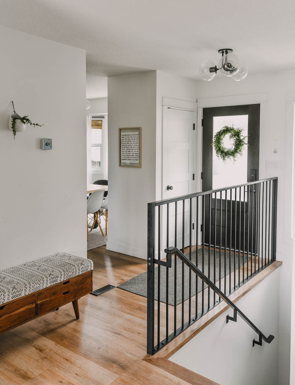 Bright, light entryway decor with modern accents