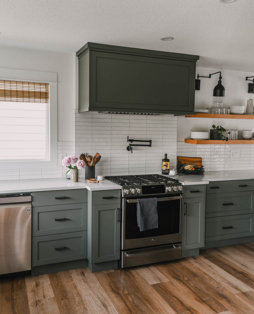 classic green shaker cabinets with white walls